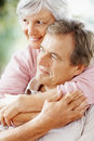 Smiling senior woman with arms around a man Royalty Free Stock Photography