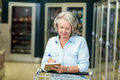 Smiling senior woman checking list Royalty Free Stock Photo