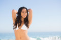 Smiling sexy brunette posing in white bikini Royalty Free Stock Photo