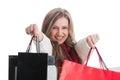 Smiling shopping girl showing shopping bags Royalty Free Stock Photo