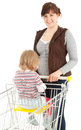 Smiling shopping mother with baby in trolley Stock Photos