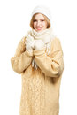 Smiling shy woman in warm clothing young winter standing isolated on white background Royalty Free Stock Photos
