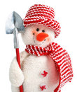 Smiling snowman toy with shovel Royalty Free Stock Photo