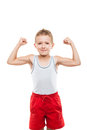 Smiling sport child boy showing hand biceps muscles strength beauty his white isolated Royalty Free Stock Photography