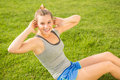Smiling sporty blonde doing sit ups Royalty Free Stock Photo