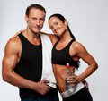 Smiling sporty couple with bottle of water Royalty Free Stock Images
