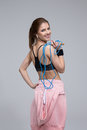 Smiling sporty woman holding skipping rope Royalty Free Stock Photo