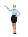 Smiling stewardess showing direction picture of Stock Photography