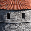 Smiling stone towers of Tallinn Stock Images