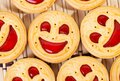 Smiling strawberry jam cookies. Close up Royalty Free Stock Photo