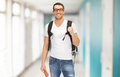 Smiling student with backpack and book Royalty Free Stock Photo