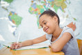 Smiling student doing class work Royalty Free Stock Photo