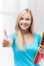 Smiling student with folders picture of showing thumbs up Royalty Free Stock Photography