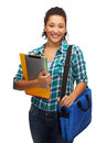 Smiling student with folders tablet pc and bag education technology people concept female african american Royalty Free Stock Photography