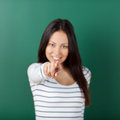 Smiling student girl pointing on you finger Stock Photography