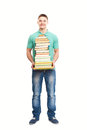 Smiling student holding big stack of books full length portrait happy isolated on white background Royalty Free Stock Images