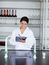 Smiling student in science writing on a clipboard Royalty Free Stock Photos