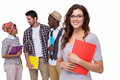 Smiling student standing with friends behind her Royalty Free Stock Photo