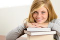 Smiling student teenager leaning head on books Royalty Free Stock Photo
