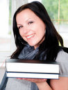 Smiling student woman with backpack holding books Stock Photography