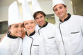 Smiling students in cooking class team of future restaurant chefs looking at camera Royalty Free Stock Photos