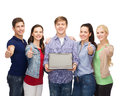Smiling students with laptop computer education advertisement and new technology concept blank screen showing thumbs up Royalty Free Stock Photography