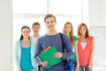 Smiling students with teenage boy in front Royalty Free Stock Photo
