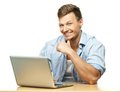 Smiling stylish man behind laptop young isolated on white Royalty Free Stock Photo