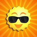 Smiling sun summer character with sunglasses as a happy ball of glowing hot seasonal fun Royalty Free Stock Images
