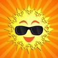 Smiling sun summer character with sunglasses as a happy ball of glowing hot seasonal fun Royalty Free Stock Image