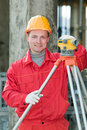 Smiling surveyor builder and level Stock Photo