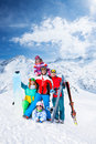 Smiling team with snowboards and skis group of happy excited men women wearing goggles standing posing on the mountains Royalty Free Stock Photography