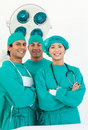 Smiling team of surgeon Stock Photos