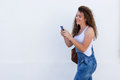 Smiling teen with cellphone and headphones walking Royalty Free Stock Photo