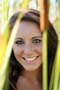 Smiling teen girl outdoor portrait amid cattails Royalty Free Stock Image