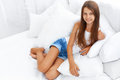 Smiling teen girl portrait on a bed Royalty Free Stock Photo