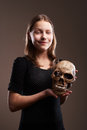 Smiling teen girl with skull
