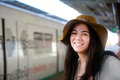 Smiling teen traveler waiting for train at station biracial in thailand Royalty Free Stock Photos