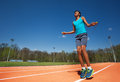 Smiling teenage athlete skipping the rope outside Royalty Free Stock Photo