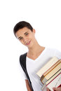 Smiling teenage boy carrying books Royalty Free Stock Photography