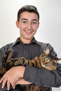 Smiling teenage boy with a cat Royalty Free Stock Photography