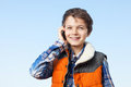Smiling teenage boy a is giving a big smile whilst on the phone Stock Images