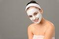 Smiling teenage girl cosmetics mask skin beauty Royalty Free Stock Photo