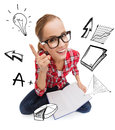 Smiling teenage girl in eyeglasses reading book Royalty Free Stock Photo