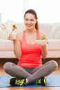Smiling teenage girl with green salad at home Royalty Free Stock Photo