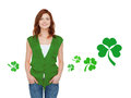 Smiling teenage girl in green vest with shamrock gestures holidays st patricks day and people concept happy teenager over white Stock Photo
