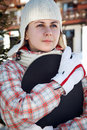 Smiling teenage girl holding snowboard Royalty Free Stock Photo