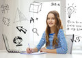 Smiling teenage girl laptop computer and notebook Royalty Free Stock Photo