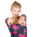 Smiling teenage girl pointing you Royalty Free Stock Photography