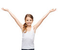 Smiling teenage girl with raised hands shirt design happiness freedom future concept in blank white shirt Stock Photo
